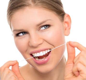 dental floss and teeth
